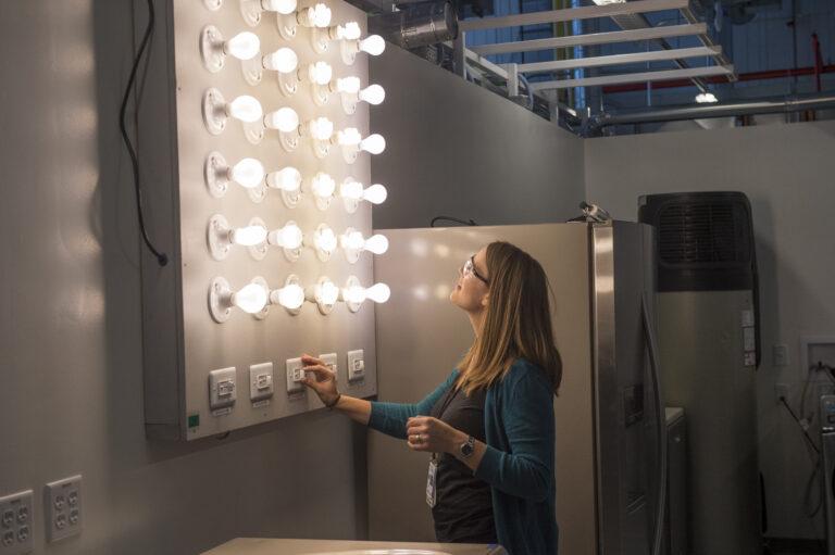 Engineer adjusts bank of dimmer lights.